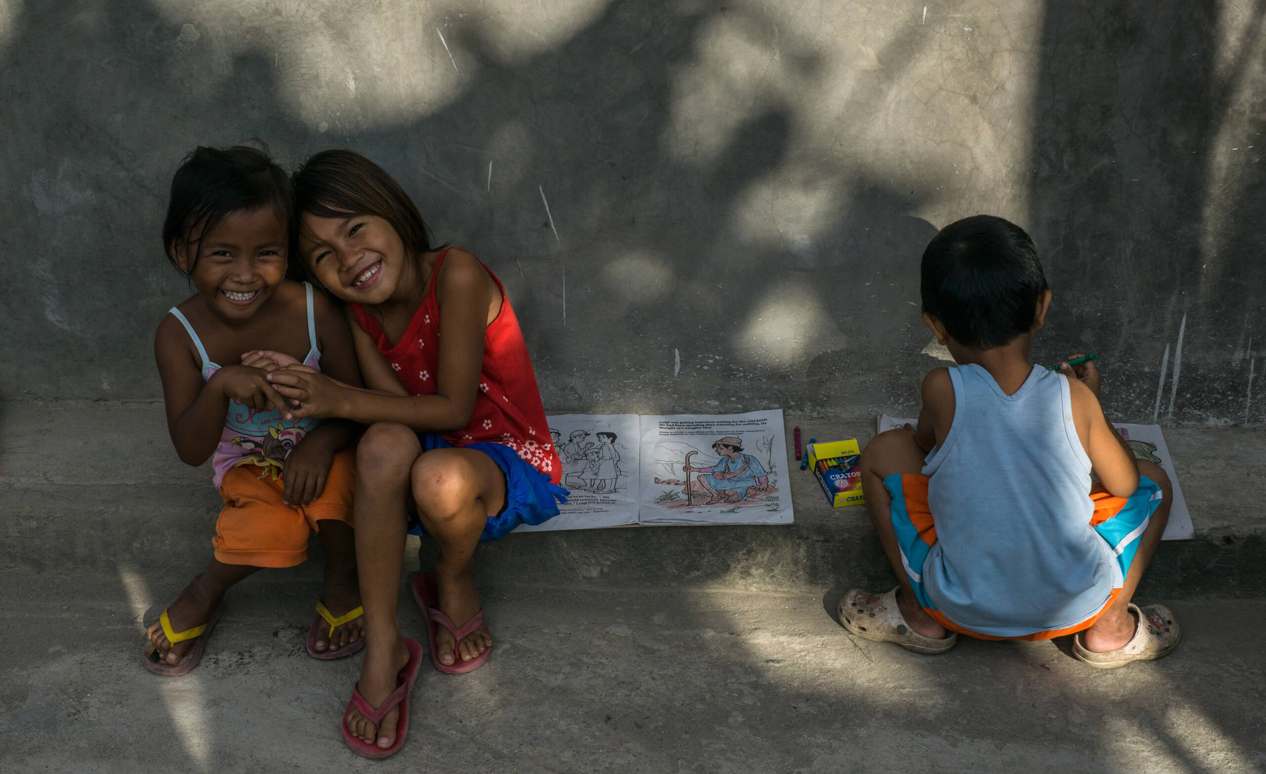 Happy kids of Lingap Center with their colouring books